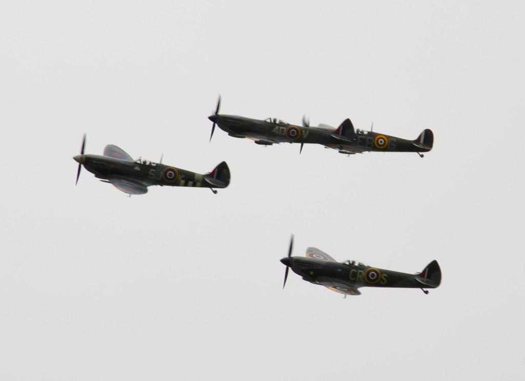 Four Spitfires flying in formation.