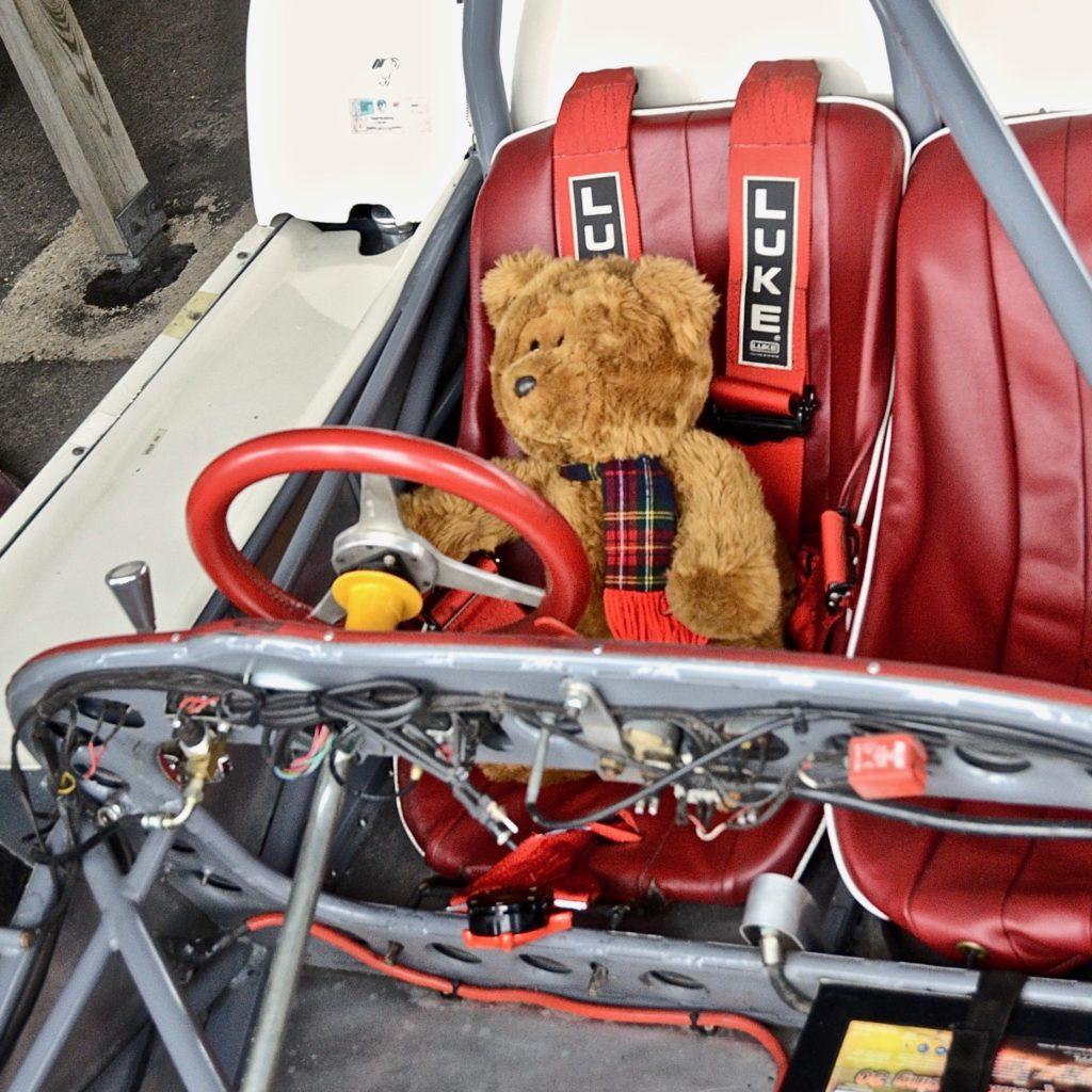 Hemel Bear in the driver's seat of the Lotus 23, in the paddock at Goodwood, during practice for the 77MM. Photo by Marcia White for Join The World Magazine.
