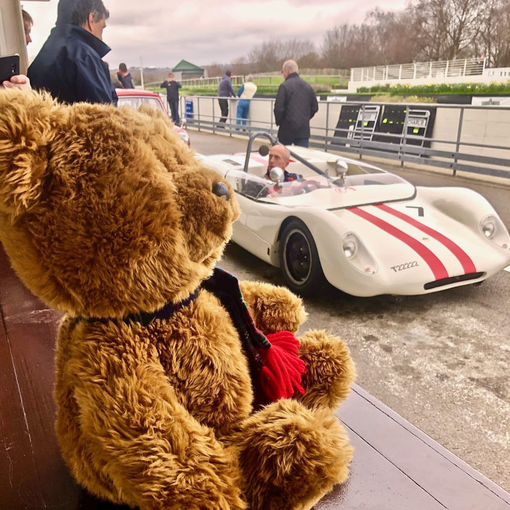 Hemel Bear sitting on the pit counter, alongside the Lotus 23, prior to practice at the Goodwood 77MM. Photo by Marcia White for Join The World Magazine.