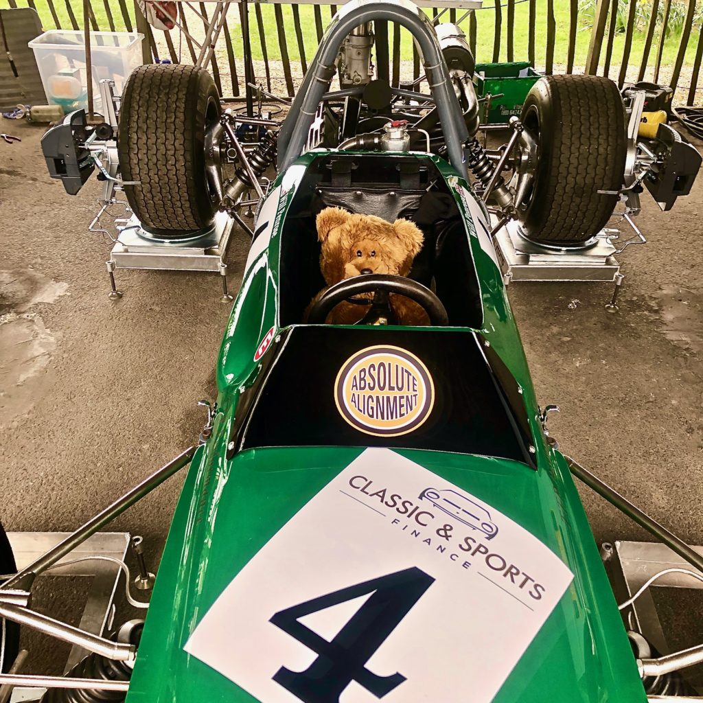 Hemel Bear in the cockpit of the Tecno Formula 3 car, in the paddock, during practice for the Goodwood 77MM.