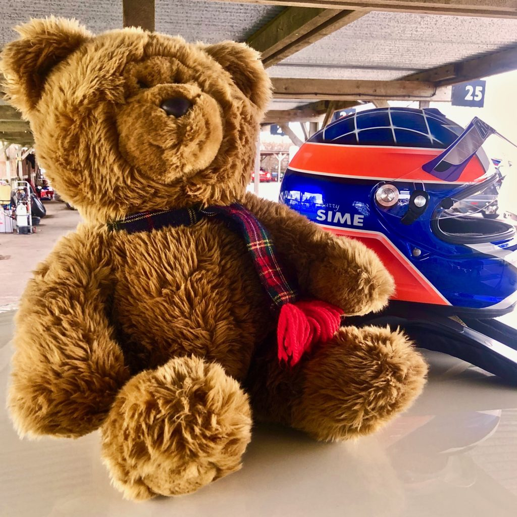 Hemel Bear on the roof of the Sime Racing Mini Cooper S. Alongside Barry Sime's helmet. Goodwood 77MM.